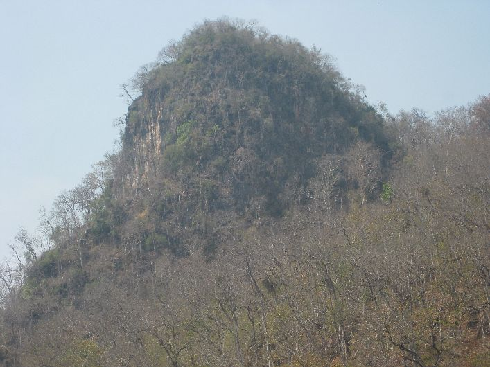 Big Knob, a rock formation on top of a hill at Tham Lot, Thailand