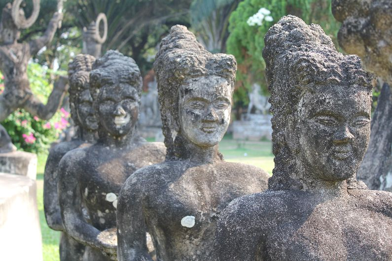 Smiling female statues