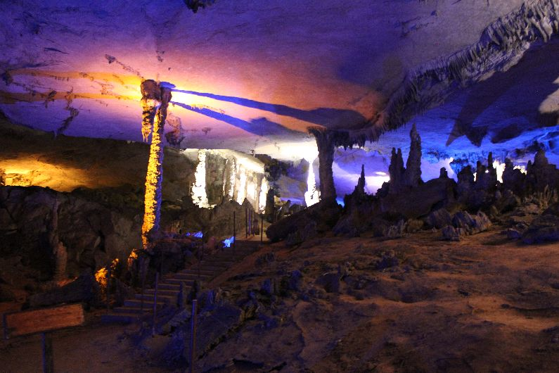 The interior of Kong Lor cave, brilliantly illuminated with blue and orange lights to create a magnificant effect