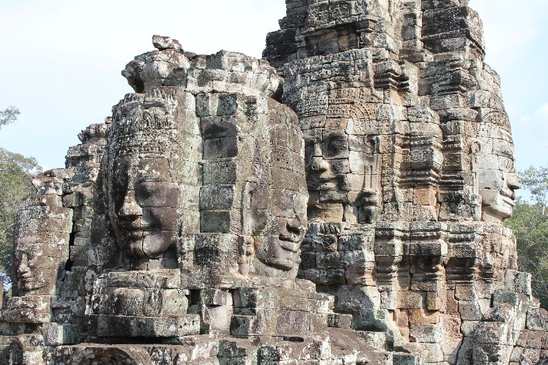 The beautiful faces of the Bayon temple, within the city of Angkor Thom