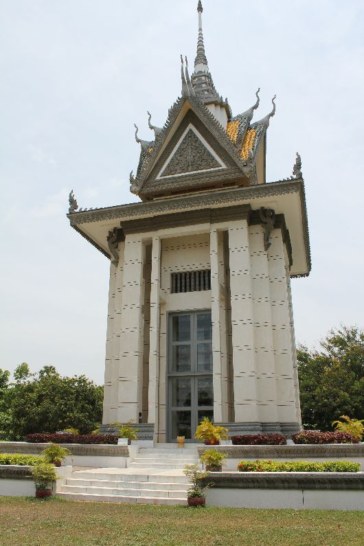 The majestic monument at the killing fields. Just visible through the glass are the shelves displaying some 8,000 victims bones.