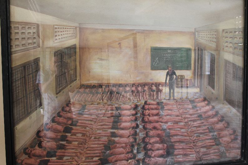 Illustration of how the victims were manacled in groups, with vast numbers per room - the rooms were all previously school classrooms.