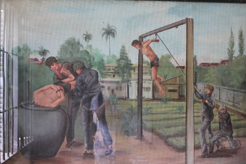 Illustration of the deplorable torture methods - in this case, strung up with hands behind the back, the victim passes out and is revived by submersion in fetid, foul water. Some of the methods carried out at S21, however, are beyond description.
