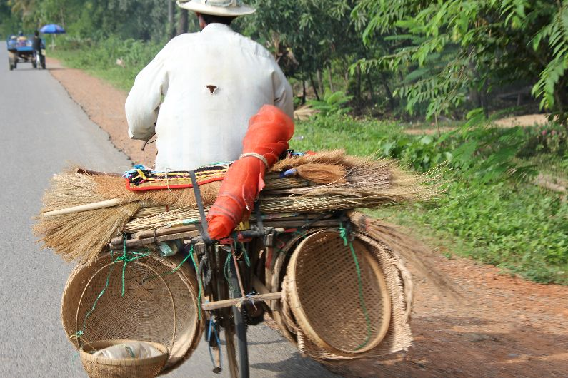 Typically resourceful - this lop-sided bike looks lightweight to some of the overloaded vehicles that are common in SE Asia