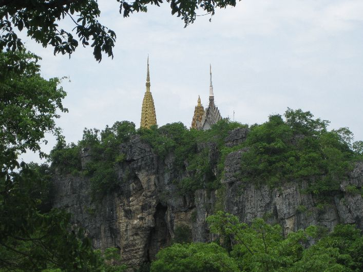 The hill where the killing cave is. A number of temples and shrines are scattered across the peak.