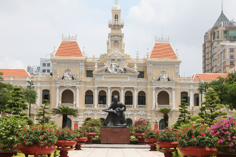 The city hall with a statue of Ho Chi Minh in front