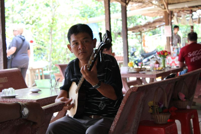 The first stop on the tour of the Mekhong Delta is (unremarkable) local fruit and tea while the 'locals' play some music and sing for your pleasure