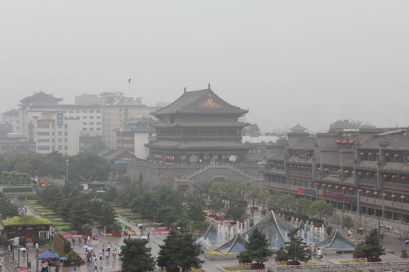 The view from the Bell Tower of the Drum Tower standing in the rainy distance