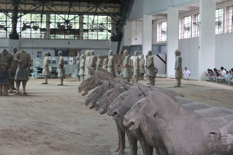 Life-size horses accompany the soldiers