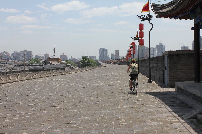 Cycling the ancient wall with the modern city in the distance