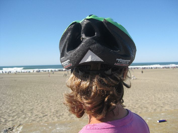 Ocean Beach, San Francisco. The cycle helmet helps to flatten down the wayward hair.